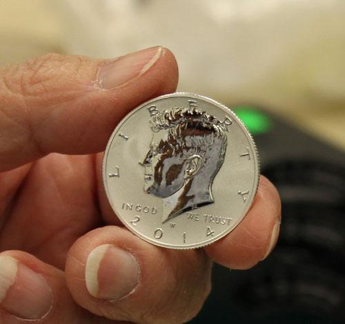 2014-W Reverse Proof Silver Kennedy Half Dollar in hand
