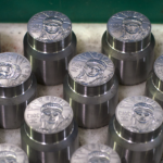 Coinage dies at the Philadelphia Mint, awaiting the production line. They will soon be used for striking American Platinum Eagles. (Source: American Gold and Platinum Eagles, by Edmund C. Moy)